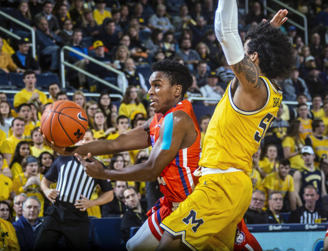 Houston Baptist guard Jalon Gates, left, attempt to get to the basket while defended by Michigan guard Eli Brooks during the first half of an NCAA college basketball game in Ann Arbor, Mich., Friday, Nov. 22, 2019. (AP Photo/Tony Ding)