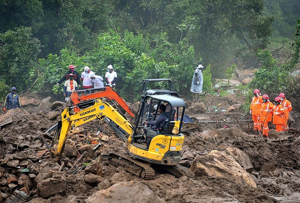 Rescue workers search for missing people after a massive landslide on August  9, 2020 swept away dozens of tea estate workers in Pettimudy, Idukki, Kerala  (Photo by STR / AFP) (Photo by STR/AFP via Getty Images)
