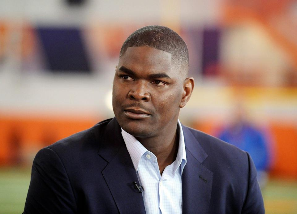 """Keyshawn Johnson called Jon Gruden a """"fraud"""" and compared him to a used car salesman during his ESPN morning radio show."""