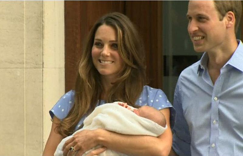 The Duke and the Duchess of Cambridge, leave The Lindo Wing of St. Mary's Hospital, in London, Tuesday, July 23, 2013, carrying their new born son, the Prince of Cambridge, who was born on Monday. into public view for the first time.