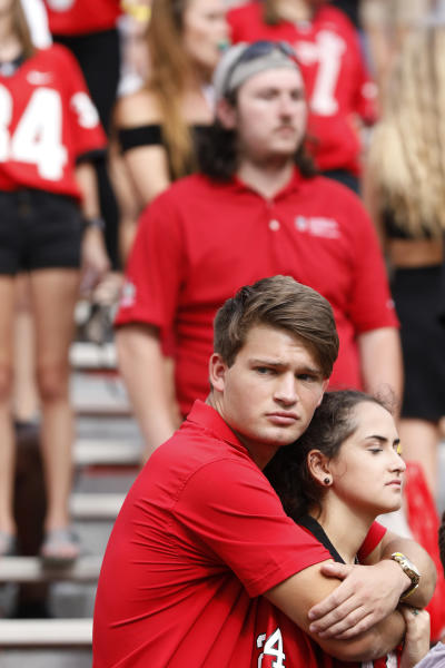 Georgia fans react after the Bulldogs lost 20-17 in double overtime to unranked South Carolina in an NCAA college football game in Athens, Ga., on Saturday, Oct. 12, 2019. (Joshua L. Jones/Athens Banner-Herald via AP)