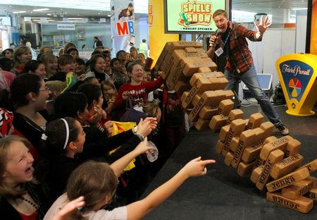 "FILE PHOTO: Children participate in an oversized ""Jenga"" game during the 25th Spielefest (games festival) in Vienna"