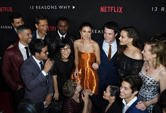 """Selena Gomez, who executive produced the series and is shown here surrounded by cast members, says she wanted to """"make something that can hopefully help people."""" (AFP Photo/Mark RALSTON)"""