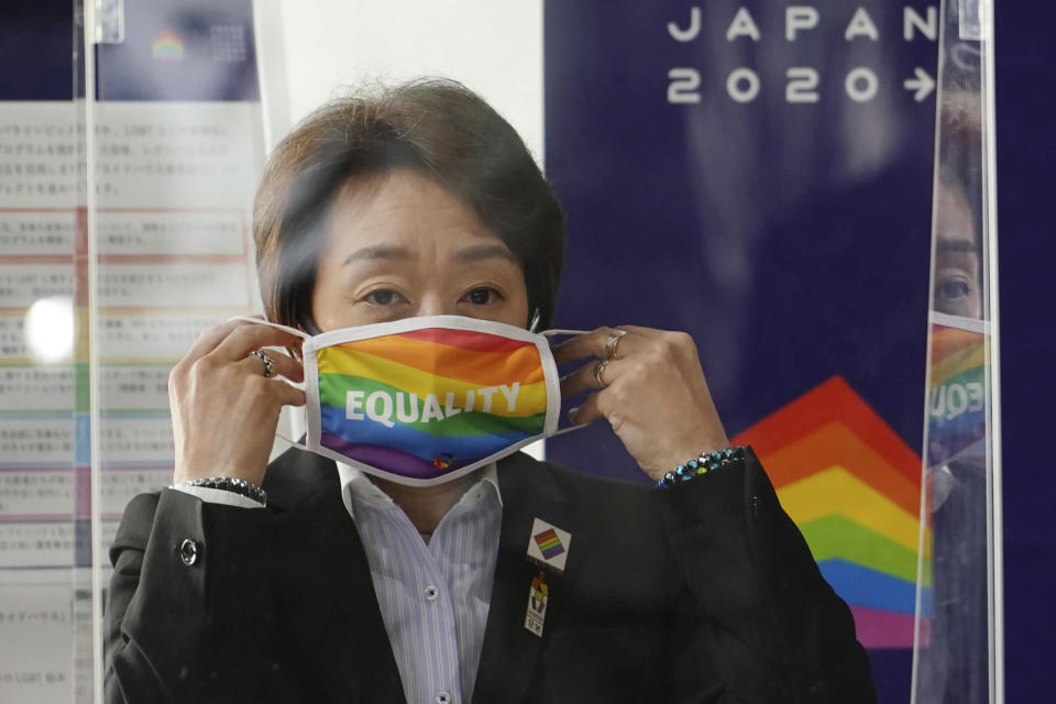 """Tokyo 2020 Organizing Committee President Seiko Hashimoto wears a rainbow-colored mask with word """"Equality"""" during her visit to Pride House Tokyo Legacy in Tokyo Tuesday, April 27, 2021. Japan marked LGBTQ week with pledge to push for equality law before the Olympics. (AP Photo/Eugene Hoshiko, Pool)"""