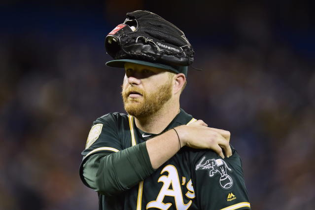 Oakland Athletics starting pitcher Brett Anderson leaves a baseball game while holding his shoulder in the second inning against the Toronto Blue Jays in Toronto on Friday, May 18, 2018. (Frank Gunn/The Canadian Press via AP)