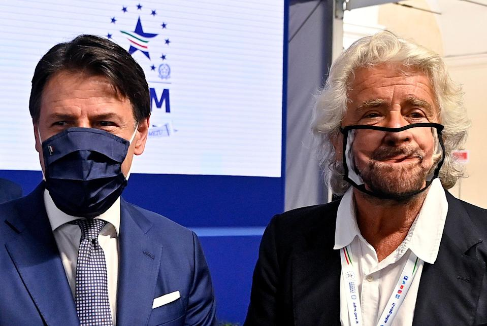 Beppe Grillo (R) with prime minister Giuseppe Conte (L) during the presentation of the 2019 Blue Book at the Customs and Monopolies Agency, Rome, Italy, 11 September 2020. ANSA/RICCARDO ANTIMIANI (Photo: Riccardo Antimiani/ANSA)