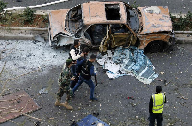 Lebanese police detain a suspect at the site of an explosion in downtown Beirut