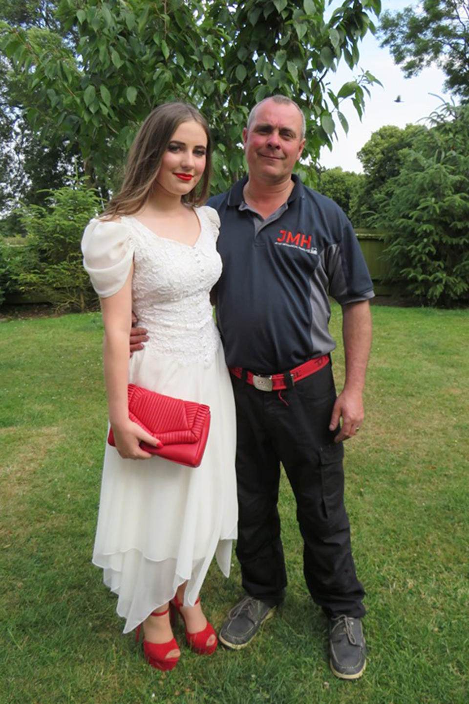 Grace photographer with her father, David, on the day of prom [Photo: Caters]