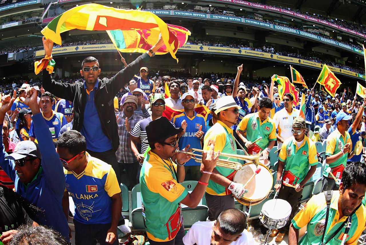 MELBOURNE, AUSTRALIA - DECEMBER 26:  Sri Lankan fans cheer during day one of the Second Test match between Australia and Sri Lanka at the Melbourne Cricket Ground on December 26, 2012 in Melbourne, Australia.  (Photo by Ryan Pierse/Getty Images)