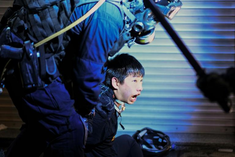 Nearly 6,000 protesters have been arrested in Hong Kong since June (AFP Photo/MANAN VATSYAYANA)