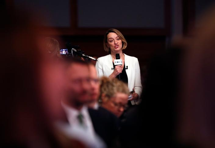 BBC Political Editor Laura Kuenssberg asks a question to Britain's Prime Minister Theresa May during the annual Confederation of British Industry (CBI) conference in central London, on November 19, 2018. - British Prime Minister Theresa May on Monday defended her draft Brexit deal to business leaders ahead of