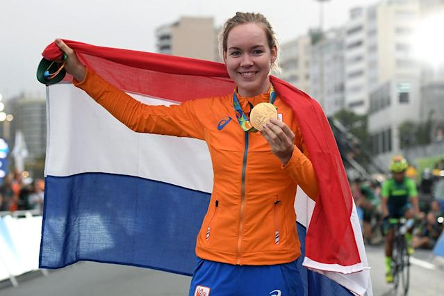 <p>Gold medalist Anna van der Breggen of the Netherlands celebrates on the podium following the Women's Road Race on Day 2 of the Rio 2016 Olympic Games at Fort Copacabana on August 7, 2016 in Rio de Janeiro, Brazil. (Photo by Matthias Hangst/Getty Images) </p>