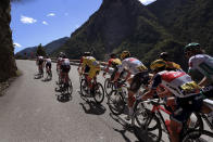 The pack climbs Colmiane pass during the second stage of the Tour de France cycling race over 186 kilometers (115,6 miles) with start and finish in Nice, southern France, Sunday, Aug. 30, 2020. (AP Photo/Thibault Camus)