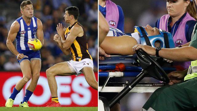 Higgins had to taken from the field on a medicab. Image: Getty