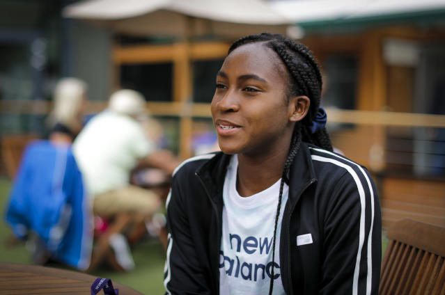 """FILE -In this July 9, 2019, file photo, United States' Cori """"Coco"""" Gauff speaks to The Associated Press during the Wimbledon Tennis Championships in London. Gauff is just 15 but got into the main draw for the U.S. Open, which starts next week, thanks to a wild-card invitation after her surprising run to the fourth round at Wimbledon. She is one of a group of young Americans making strides in tennis lately. (AP Photo/Ben Curtis, File)"""