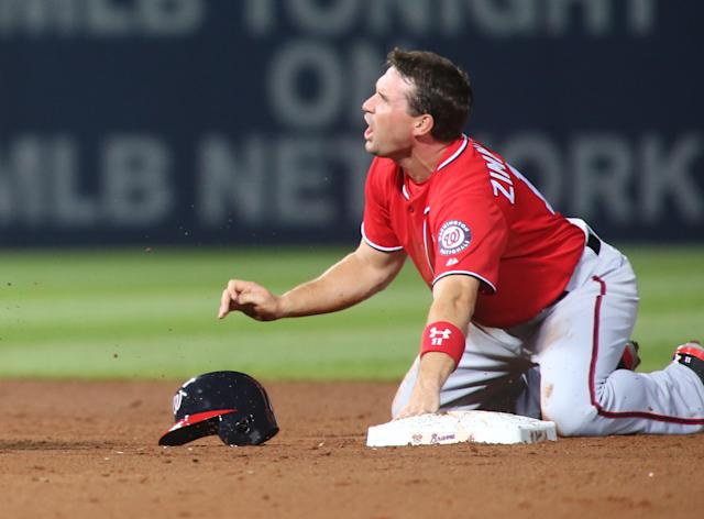 Washington Nationals' Ryan Zimmerman (11) reacts after getting tagged out by Atlanta Braves shortstop Andrelton Simmons on second base on a pickoff by Atlanta Braves starting pitcher Alex Wood in the fifth inning of their baseball game Saturday, April 12, 2014, in Atlanta. Zimmerman broke his right thumb on the play. (AP Photo/Jason Getz)