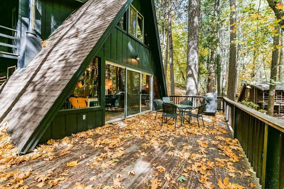 "<p><strong>Twain Harte, California</strong></p> <p>We love a good A-frame cabin, and this forest green three-bedroom home is no exception. Located in Twain Harte, it's the furthest from Yosemite National Park of all the homes on this list, at about an hour and a half's drive away. You won't be short on nature, though: It's 30 minutes away from Pinecrest Lake & Dodge Ridge Ski Resort and is set in the woods, with two private lakes nearby. There is Wi-Fi, but service can be spotty, so a land line is among the house's amenities, along with a Pack 'n Play, high chair, and stair gates for families traveling with young kids, an outdoor BBQ, and cooking basics from pots and pans to spices.</p> <p><strong>Book now:</strong> <a href=""https://airbnb.pvxt.net/n7b5o"" rel=""nofollow noopener"" target=""_blank"" data-ylk=""slk:From $139 per night, airbnb.com"" class=""link rapid-noclick-resp"">From $139 per night, airbnb.com</a></p>"