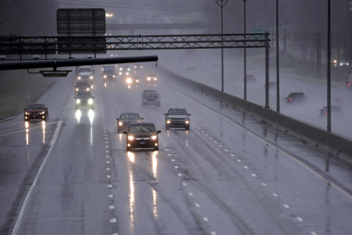 Drivers navigate slippery conditions caused by freezing rain along Interstate 40/85 near Burlington, N.C., Thursday, Feb. 18, 2021 as winter weather moves through the state. (AP Photo/Gerry Broome)