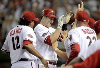 Arizona manager Kirk Gibson (right) greets Goldschmidt as he returns to the dugout following his fifth-inning grand slam