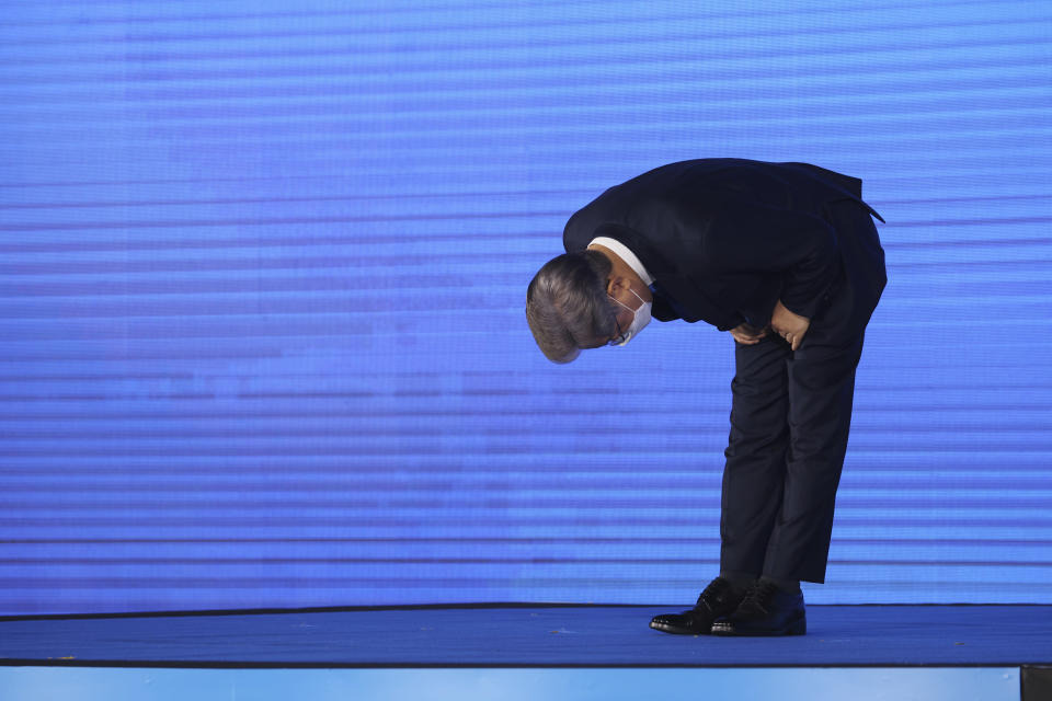 Gyeonggi Gov. Lee Jae-myung, left, elected as the ruling Democratic Party's candidate for next year's presidential election, bows after winning the party's final race in Seoul, South Korea, Sunday, Oct. 10, 2021. (Kim Hong-ji/Pool Photo via AP)