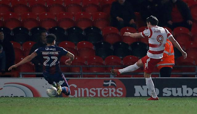 "Soccer Football - League One - Doncaster Rovers vs Bradford City - Keepmoat Stadium, Doncaster, Britain - March 19, 2018 Doncaster Rovers' John Marquis scores their second goal Action Images/Craig Brough EDITORIAL USE ONLY. No use with unauthorized audio, video, data, fixture lists, club/league logos or ""live"" services. Online in-match use limited to 75 images, no video emulation. No use in betting, games or single club/league/player publications. Please contact your account representative for further details."