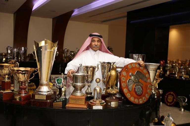 Former Qatar striker Hassan Mattar is surrounded with trophies and cups at the headquarters of the Al-Sadd club in Doha