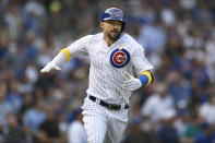 Chicago Cubs' Nicholas Castellanos celebrates after hitting a two-run home run during the first inning of a baseball game against the Pittsburgh Pirates, Friday, Sept. 13, 2019, in Chicago. (AP Photo/Paul Beaty)