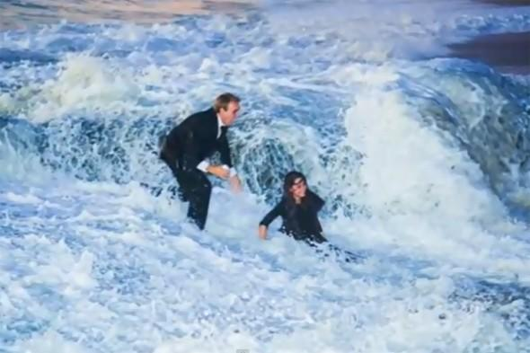 Woman literally swept off her feet when wave crashes boyfriend's proposal is a washout