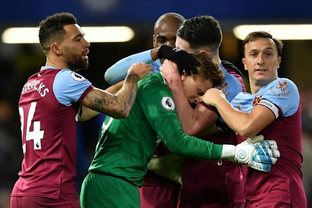 West Ham goalkeeper David Martin celebrates with team-mates after their win at Chelsea (AFP Photo/Ben STANSALL)