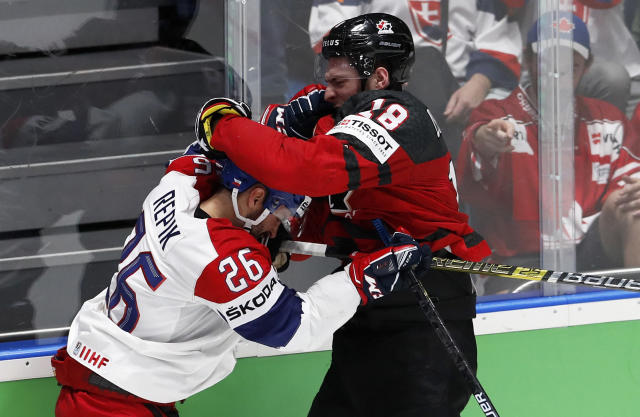 Czech Republic's Michal Repik, left, and Canada's Pierre-Luc Dubois get involved in a scuffle during the Ice Hockey World Championships semifinal match between Canada and Czech Republic at the Ondrej Nepela Arena in Bratislava, Slovakia, Saturday, May 25, 2019. (AP Photo/Petr David Josek)
