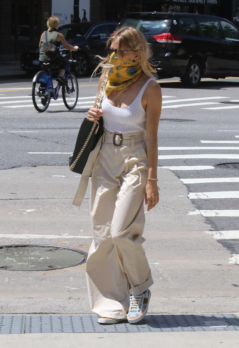 Sienna Miller wears Mango trousers while out and about in New York City. (Getty Images)