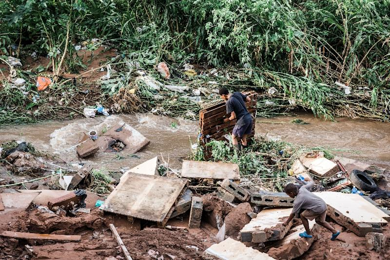 In addition to collapsed buildings and flooded roads, sewer lines were blocked and electricity pylons had toppled over (AFP Photo/RAJESH JANTILAL)