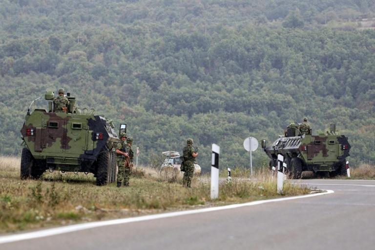 Serbia deployed four armoured vehicles close to the Jarinje border crossing into Kosovo (AFP/Irfan LICINA)