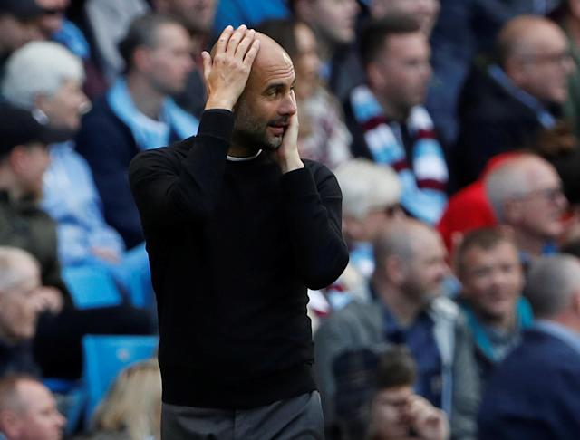 "Soccer Football - Premier League - Manchester City v Swansea City - Etihad Stadium, Manchester, Britain - April 22, 2018 Manchester City manager Pep Guardiola reacts Action Images via Reuters/Lee Smith EDITORIAL USE ONLY. No use with unauthorized audio, video, data, fixture lists, club/league logos or ""live"" services. Online in-match use limited to 75 images, no video emulation. No use in betting, games or single club/league/player publications. Please contact your account representative for further details."
