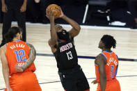 Houston Rockets' James Harden (13) shoots as Oklahoma City Thunder's Luguentz Dort (5) and Steven Adams (12) defend during the second half of an NBA basketball first round playoff game Saturday, Aug. 29, 2020, in Lake Buena Vista, Fla. (AP Photo/Ashley Landis)