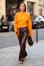 <p>Leather trousers might not be everyone's cup of tea but they're actually kinda great for wearing on those cooler overcast days, especially when paired with a colour pop blouse and flip-flop heels.</p>