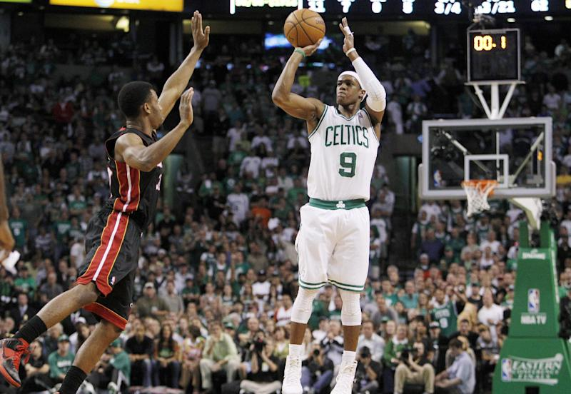 Boston Celtics guard Rajon Rondo (9) shoots against Miami Heat guard Norris Cole (30) during the first quarter of Game 4 in their NBA basketball Eastern Conference finals playoff series in Boston, Sunday, June 3, 2012. (AP Photo/Elise Amendola)
