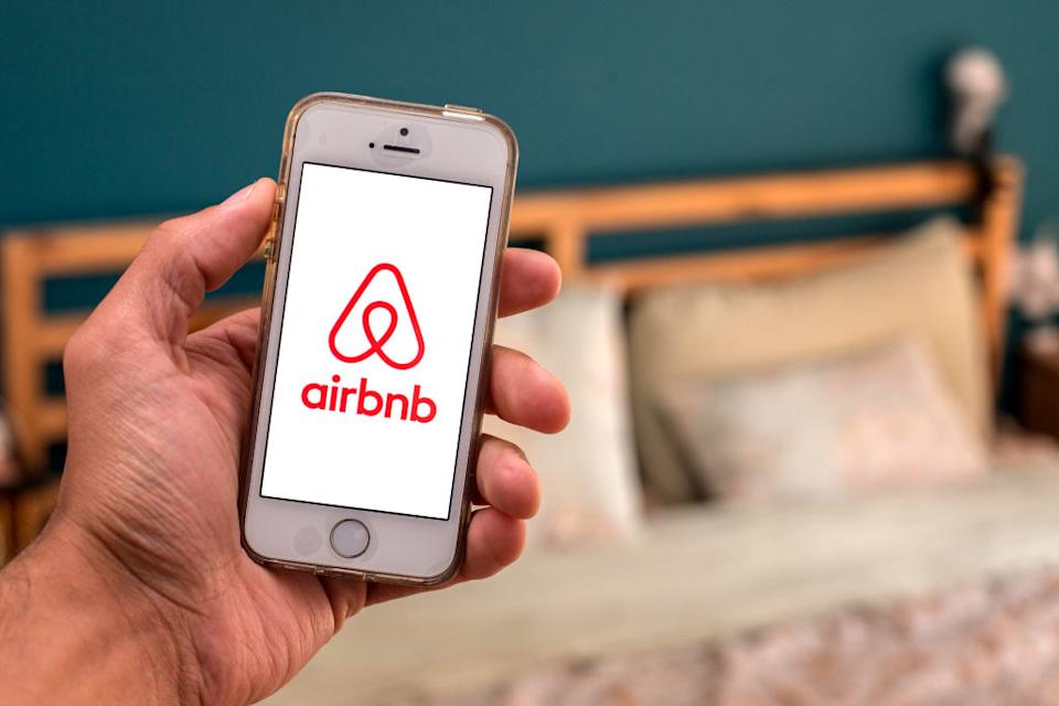 In this photo illustration, the Airbnb app seen displayed on a smartphone screen.