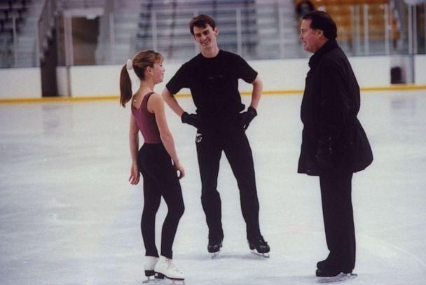 PHOTO: In this file photo from 1997, figure skating champion Todd Eldredge (C) chats with figure skating champion Tara Lipinski & his coach Richard Callaghan during a break in practice session at the Detroit Skating Club. (Taro Yamasaki/The LIFE Images Collection via Getty Images, FILE)
