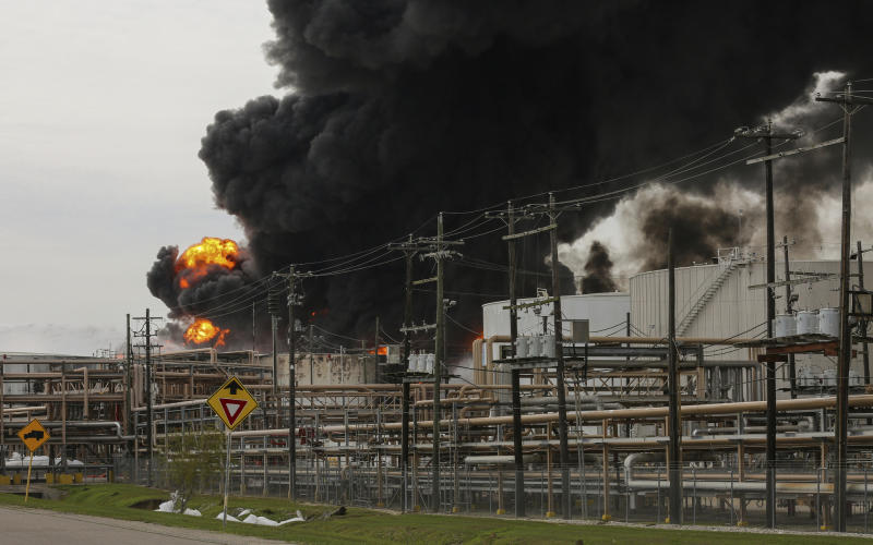 FILE - In this Monday, March 18, 2019 file photo, Firefighters battle a petrochemical fire at the Intercontinental Terminals Company in Deer Park, Texas. A fire at a Houston-area petrochemical storage facility that burned for days in March was accidental and caused by equipment failure at a storage tank, according to a report released by local and federal investigators, Friday, Dec. 6, 2019 (Godofredo A. Vasquez/Houston Chronicle via AP, File)