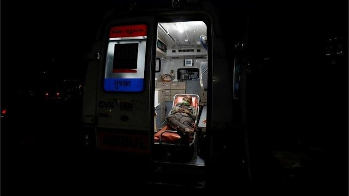 A patient lies inside an ambulance waiting in a queue to enter a COVID-19 hospital, amidst the spread of the coronavirus disease (COVID-19) in Ahmedabad, India, April 14, 2021