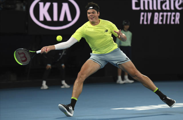 Canada's Milos Raonic makes a forehand return to Serbia's Novak Djokovic during their quarterfinal match at the Australian Open tennis championship in Melbourne, Australia, Tuesday, Jan. 28, 2020. (AP Photo/Andy Brownbill)