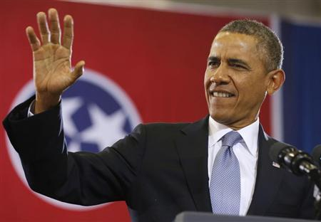 U.S. President Barack Obama waves before he speaks at McGavock High School in Nashville