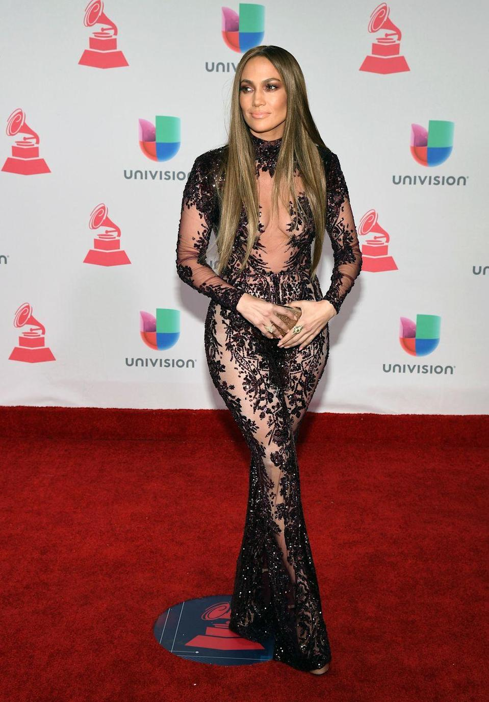 <p>Jennifer wears a sequined, lace, and v sheer black gown to the Latin Grammy Awards in Las Vegas, where she also performed with now-ex-husband Marc Anthony. </p>