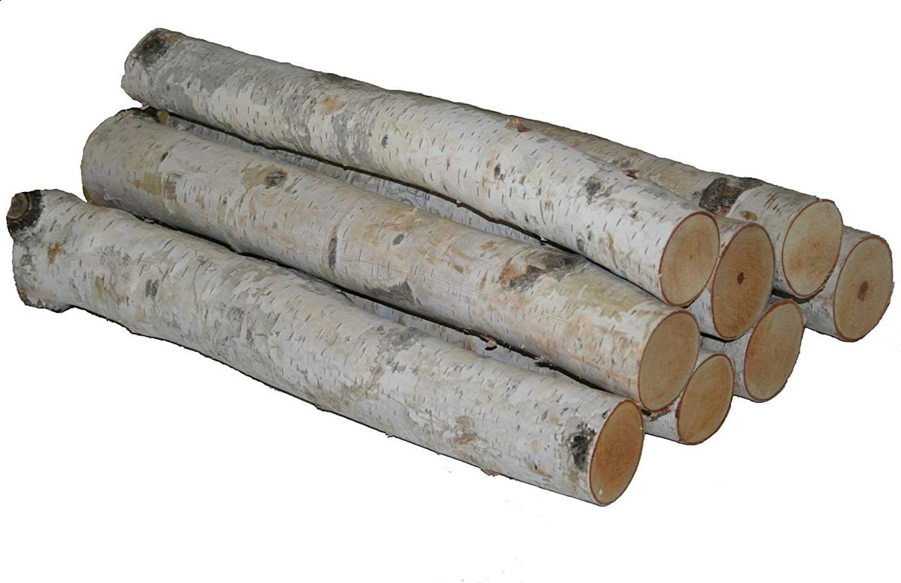 "<p>This <a href=""https://www.popsugar.com/buy/Wilson-Enterprises-White-Birch-Log-Bundle-518648?p_name=Wilson%20Enterprises%20White%20Birch%20Log%20Bundle&retailer=amazon.com&pid=518648&price=37&evar1=casa%3Aus&evar9=46907457&evar98=https%3A%2F%2Fwww.popsugar.com%2Fhome%2Fphoto-gallery%2F46907457%2Fimage%2F46907467%2FWilson-Enterprises-White-Birch-Log-Bundle&list1=shopping%2Camazon%2Choliday%2Choliday%20decor&prop13=api&pdata=1"" rel=""nofollow"" data-shoppable-link=""1"" target=""_blank"" class=""ga-track"" data-ga-category=""Related"" data-ga-label=""https://www.amazon.com/dp/B0013FEQHY/ref=s9_acsd_bw_wf_a_x_cdl_70?pf_rd_m=ATVPDKIKX0DER&amp;pf_rd_s=merchandised-search-top-3&amp;pf_rd_r=A02FT0475Q40D4RBVE4V&amp;pf_rd_t=101&amp;pf_rd_p=36cfdcb4-20ef-4a22-acea-df4c91e6ab81&amp;pf_rd_i=20435127011"" data-ga-action=""In-Line Links"">Wilson Enterprises White Birch Log Bundle</a> ($37) just feels like Winter.</p>"