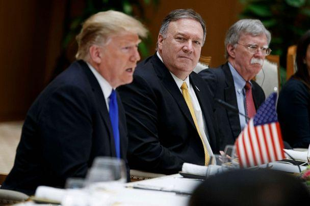 PHOTO: Secretary of State Mike Pompeo, center, and national security adviser John Bolton, right, listen as President Donald Trump speaks during a meeting with Vietnamese Prime Minister Nguyen Xuan Phuc, Feb. 27, 2019, in Hanoi, Vietnam. (Evan Vucci/AP, FILE)