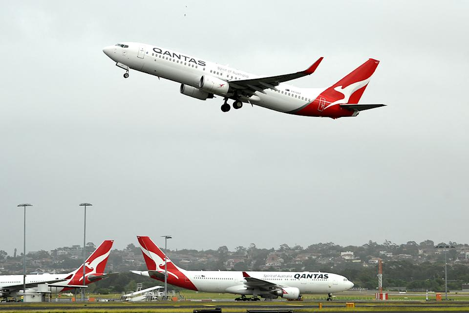 A Qantas plane takes off from the Sydney International airport on May 6, 2021, as Australia's competition regulator said it would block a pricing, code-sharing and scheduling deal between Qantas and Japan Airlines because it would likely mean higher fares for passengers. (Photo by Saeed KHAN / AFP) (Photo by SAEED KHAN/AFP via Getty Images)