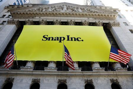 FILE PHOTO: The front of the New York Stock Exchange (NYSE) with a Snap Inc. logo hung on the front of it stands shortly before the company's IPO in New York, U.S., March 2, 2017. REUTERS/Lucas Jackson