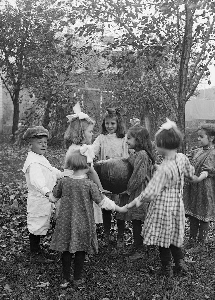 """<p>Halloween party guests in the 1920s enjoyed games like a pumpkin ring toss as a form of good old-fashioned entertainment. Apple bobbing was also a popular pastime—one <a href=""""https://www.womansday.com/relationships/dating-marriage/g1903/lost-halloween-traditions/"""" rel=""""nofollow noopener"""" target=""""_blank"""" data-ylk=""""slk:lost tradition"""" class=""""link rapid-noclick-resp"""">lost tradition</a> on October 31 even involved women secretly marking the apples before throwing them in the tub for men to """"bob"""" for; future matches were foretold depending on the apple each lad chose.</p>"""