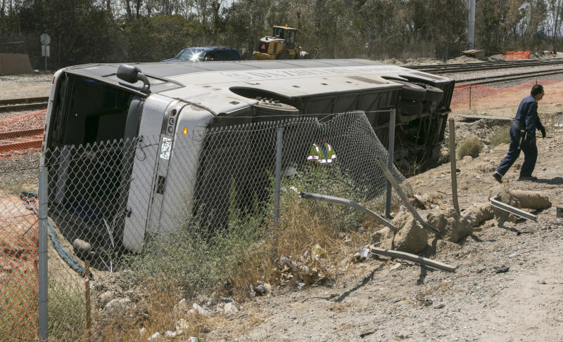 Tour bus overturns along Calif. freeway; 52 hurt